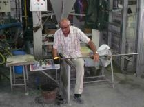 The grand master of glass blowing demonstrates his talent