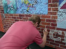 Tony signs the peace line