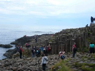 Tourists clambering over the World Heritage site
