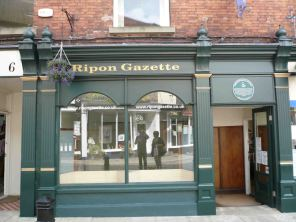 Another community newspaper the Ripon Gazette with us reflected in the window!
