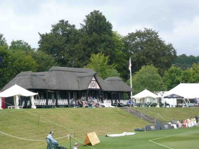 A glorious cricket ground - you can just see me sitting on the bench alongside the players, in a pinkish top